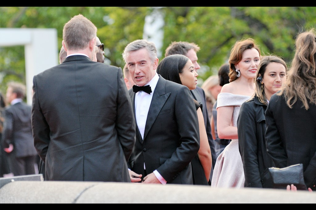 """Hold on, duty calls. I believe I'm required to look smoulderingly at that trio of gentlemen photographing me from outside the event. I don't even ask 'why?' anymore…""  Steve Coogan was dual-Oscar nominated for 'Philomena' in 2014, and was in 'Stan and Ollie'."