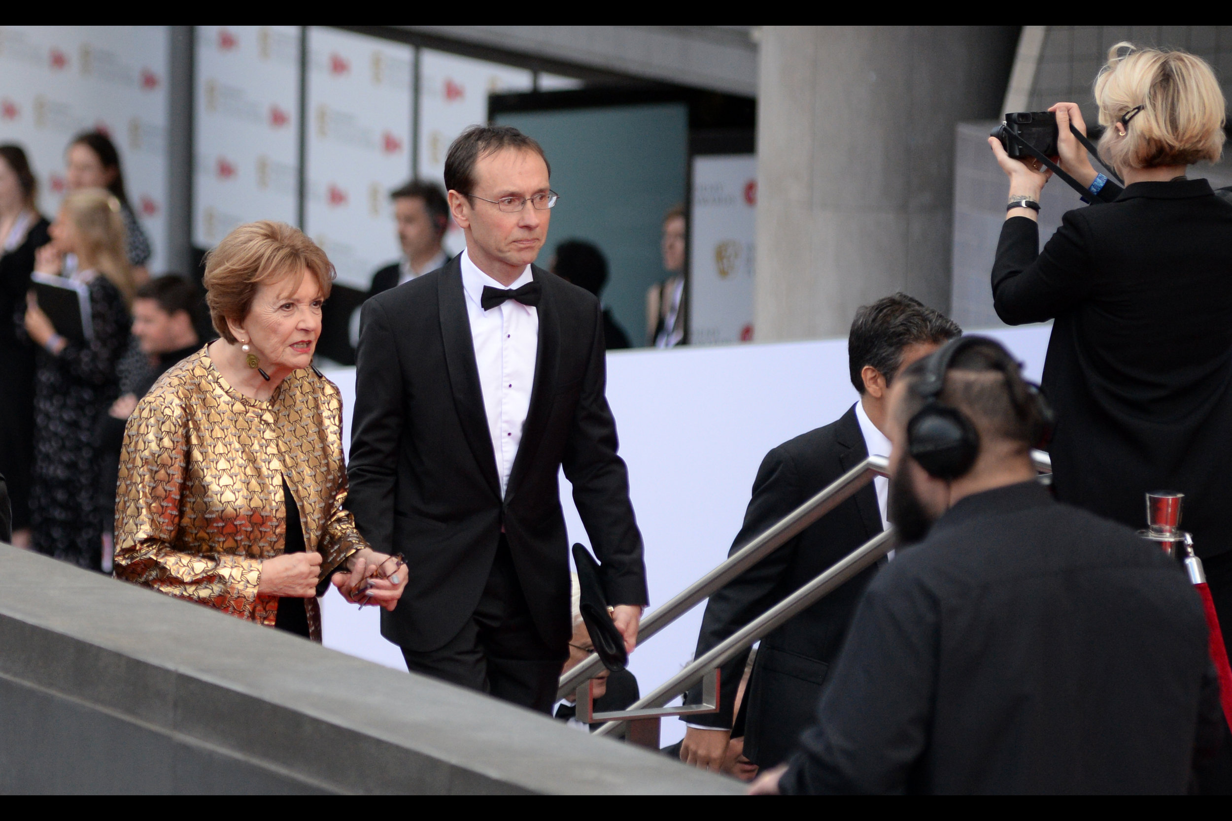 """""""We're still calling it a 'fellowship'? The misogyny runs deep in this 'burg…"""" """"But aren't ships inherently female, ma'am?"""" """"I'm a Baroness and my understanding is I could have you executed at whim, young man…""""  At left, Baroness Joan Bakewell was awarded a Bafta Fellowship on the night."""
