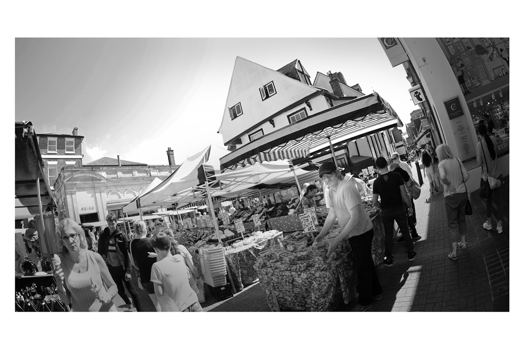 1. ST ALBANS MARKET  - it was a Saturday and the markets stretch along most of the main street in St Albans - I knew that I'd want a nice background and context almost more than the market itself, so I chose a shot in front of this distinctive building.  On Reflection : if I'd done this whole series in colour rather than black'n'white, this is the photo that would have been improved the most.