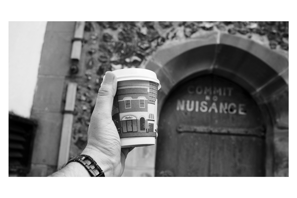 14. COFFEE  - I had a coffee cup from my favourite St Albans haunt, Charlie's Coffee and Company lying around so I used it as a prop, and I knew I wanted to take a photo with this (arguably) 'famous' door in the background, even if blurry.  On reflection : should've done this shot with a pineapple, and the coffee cup (perhaps) at the top of the clock tower. It would have fit both props better, I think.