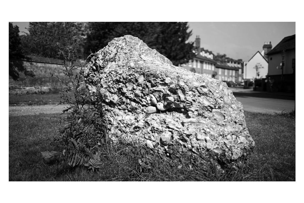"""20. PUDDING.  St Albans has a Pudding Van that's parked outside the train station on afternoons, but on weekends it's parked near a mall. I took a shot but couldn't make myself love it. However, 'Puddingstone' is mined in Hertfordshire and I was told a large boulder of it was near the Old Water Mill (aka. The Waffle House).. I took only three shots, and I still kind of had to cheat with the composition in post-processing.  On Reflection : I had an alternate : an antiques shot on George Street had a Polished Puddingstone (""""Take home a piece of St Albans!"""") in its front display window. I took the shot but the price tag of the neighbouring mini-teracotta warrior was too distracting… I should have used it (maybe) and digitally removed the price tag (maybe)"""