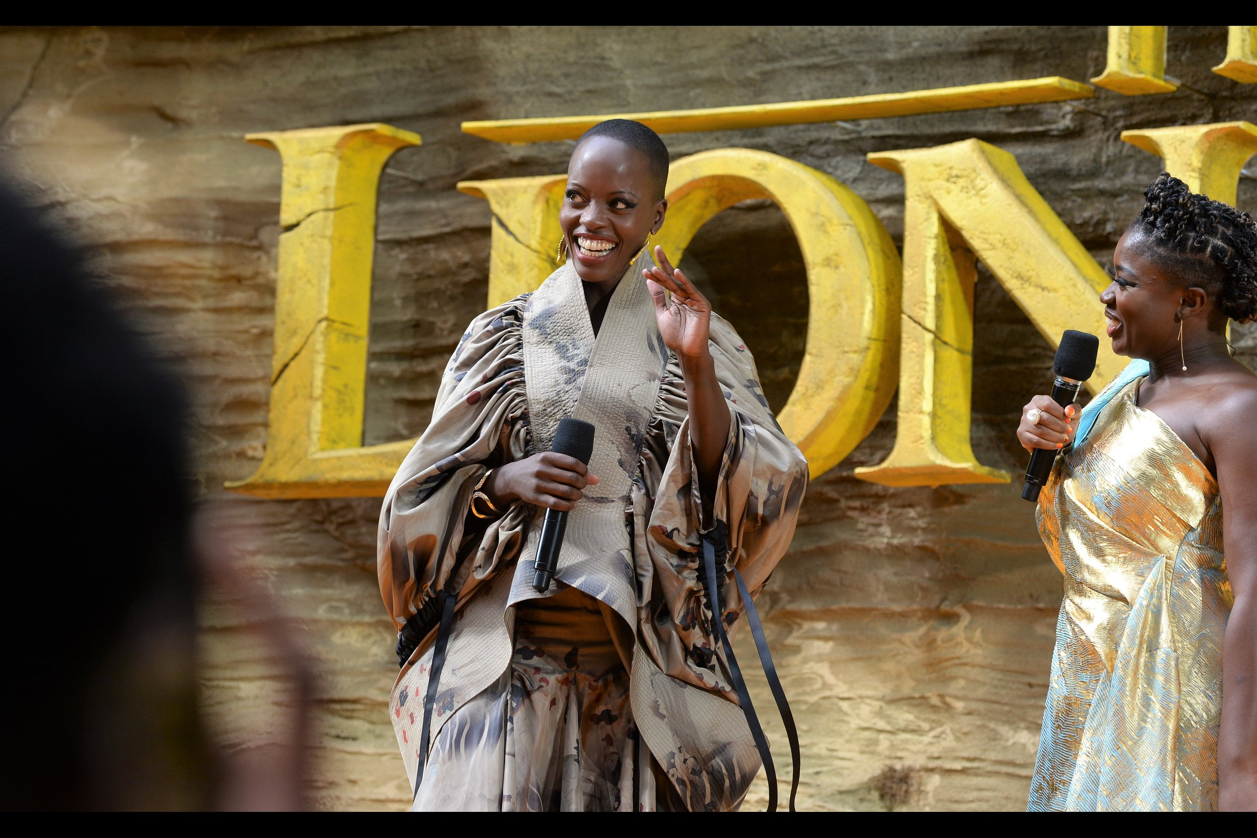 """Okay, I'll smile. But mainly because I also have money riding on that bet you placed""  Florence Kasumba is a German-based actress who'd actually had a year of experience playing her character on stage before playing it in this film."