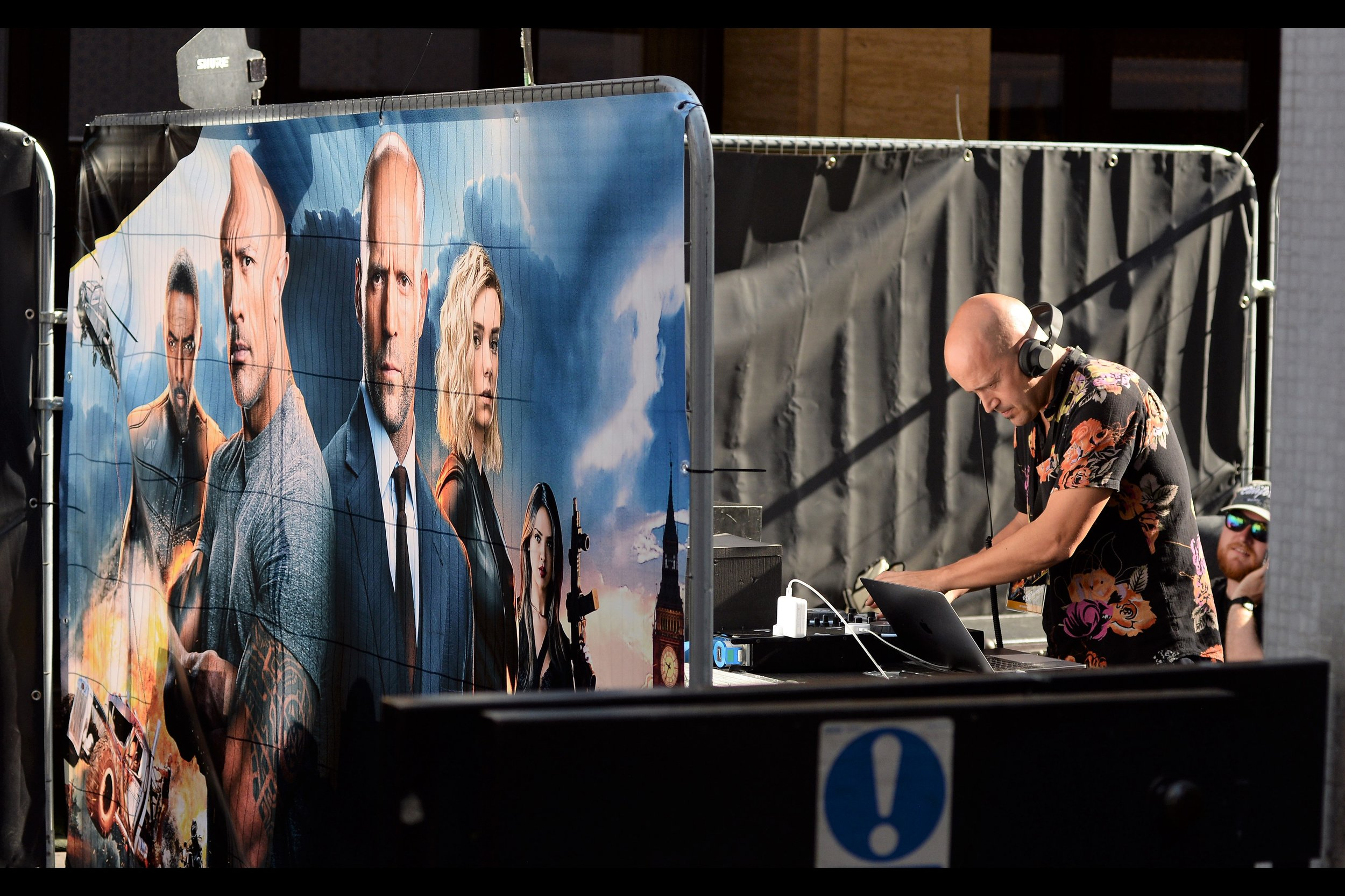 To the dismay of all present, your good friend and mine Mr Impact and his tame DJ Franch-Issize were not here to host the warmup. To this day I have never seen him at a premiere in Mayfair. But given this movie's two leads are men with minimal hair, it makes sense that even with this shirt, our Deejay was this man.