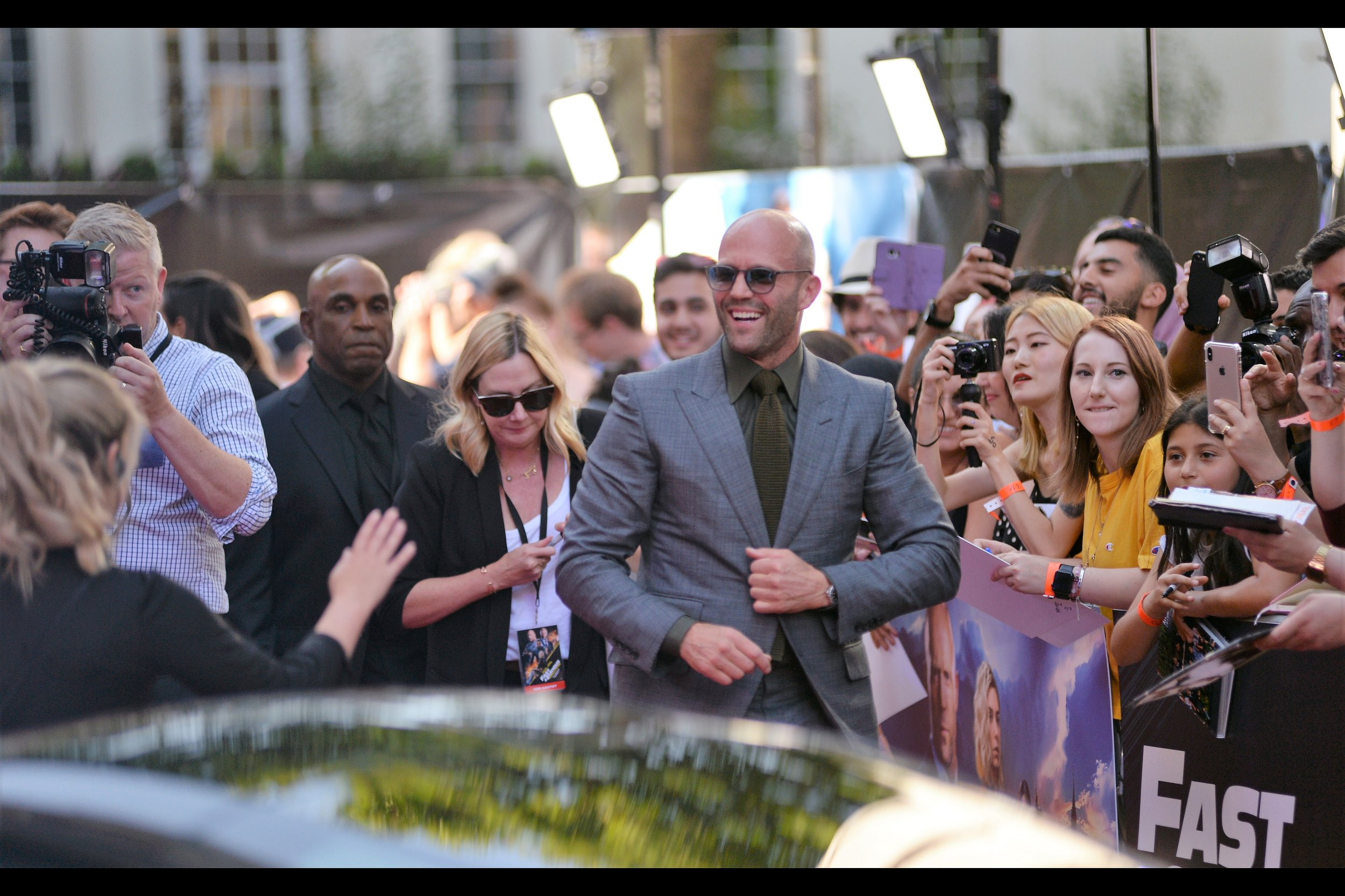 It's Jason Statham! Not only does he bear a striking similarity to me, and vice versa (except for his supermodel girlfriend, sure) but he's now parlayed an uncredited role at the tail of the 6th film (as a villain) into roles in the 7th and 8th films… and he's now a hero in this side-project!