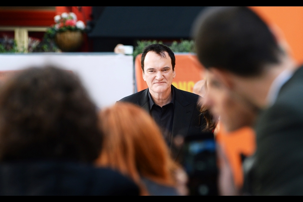 """You're all so polite…..if none of you has the courage to scream at me to motherf—king stand over by the motherf—king posing board, there's every chance I'm not going to take you seriously""  it's writer/director Quentin Tarantino!! - I've previously photographed him at the premieres of    'Inglourious Basterds'   ,    'Django Unchained   ' and    'The H8teful Eight'    (and i have a signed framed photo of him that I took hanging on my wall)"