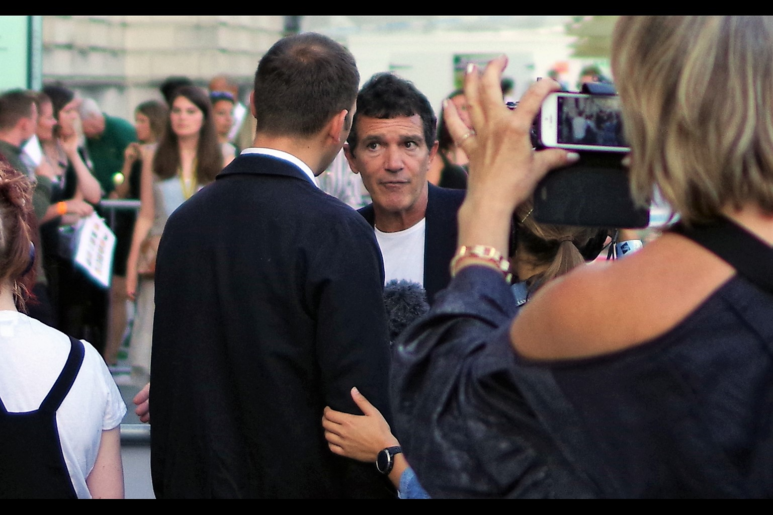 """I'm not sure why she's grabbing your arm and not mine… where am I going wrong here?""  Antonio Banderas looks confused."