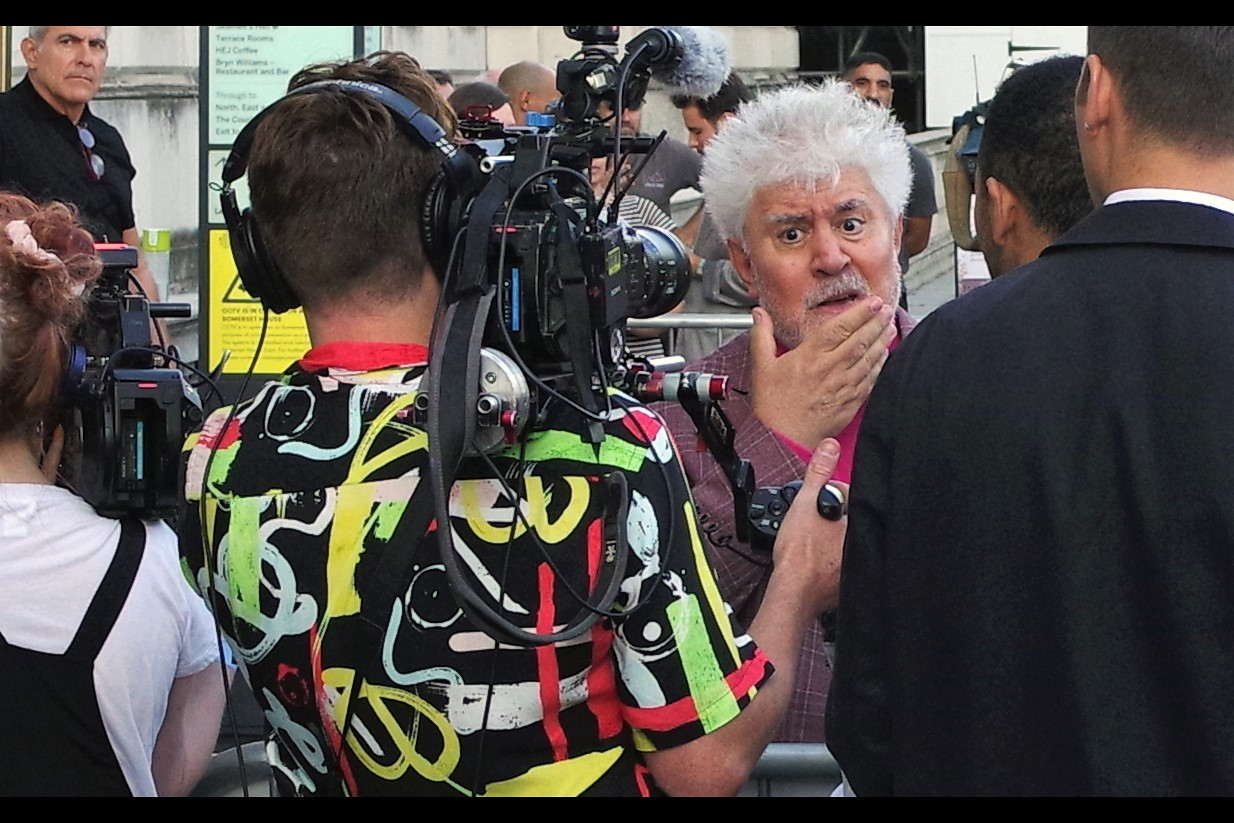 """Have I ever considered a return to black'n'white film? Never more than now, if I'm honest""  Pedro Almodovar is regarding that cameraman's amazing shirt with about a third of the awe it should really be entitled to, in my opinion."