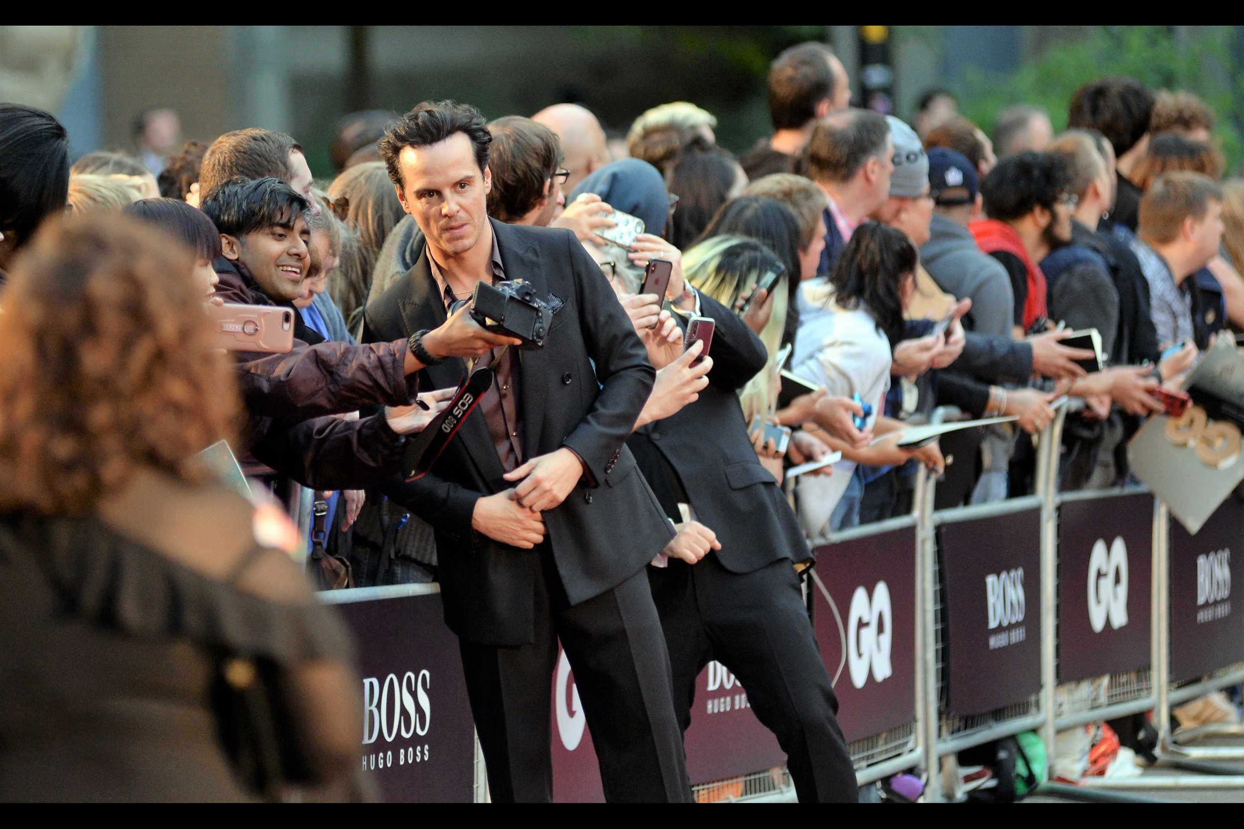 """Hold it slightly higher, bro. I know how these cameras work…""  It's Andrew Scott! (he was ""C"" in the James Bond movie 'Spectre', among other things) (edited to add : he won the ""Blurry T-Shirt Brand Name Standout Performance"" Award on the night)"