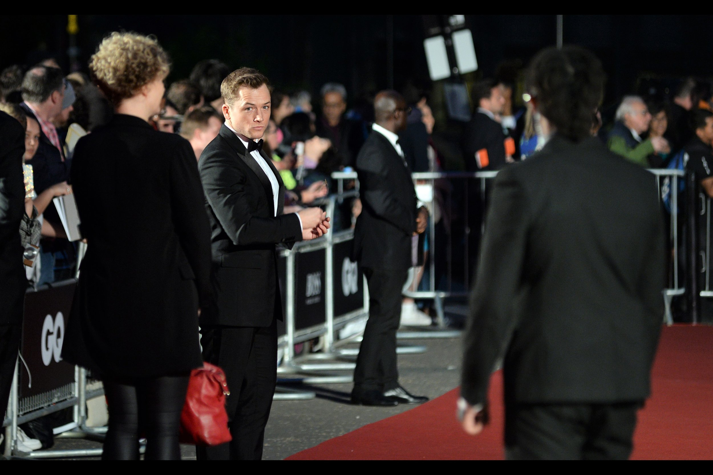 "That disapproving look (which I'd like to think, and therefore will claim, was in the direction of that Blurry Boss T-Shirt-Clipboard Guy, and not me) is better than any shot I've managed of Taron Egerton across not    one    but    TWO Kingsman premieres    ,    Eddie the Eagle   , AND the world premiere of    Rocketman   … (edited to add : he won ""Actor of the Year"" on the night)"