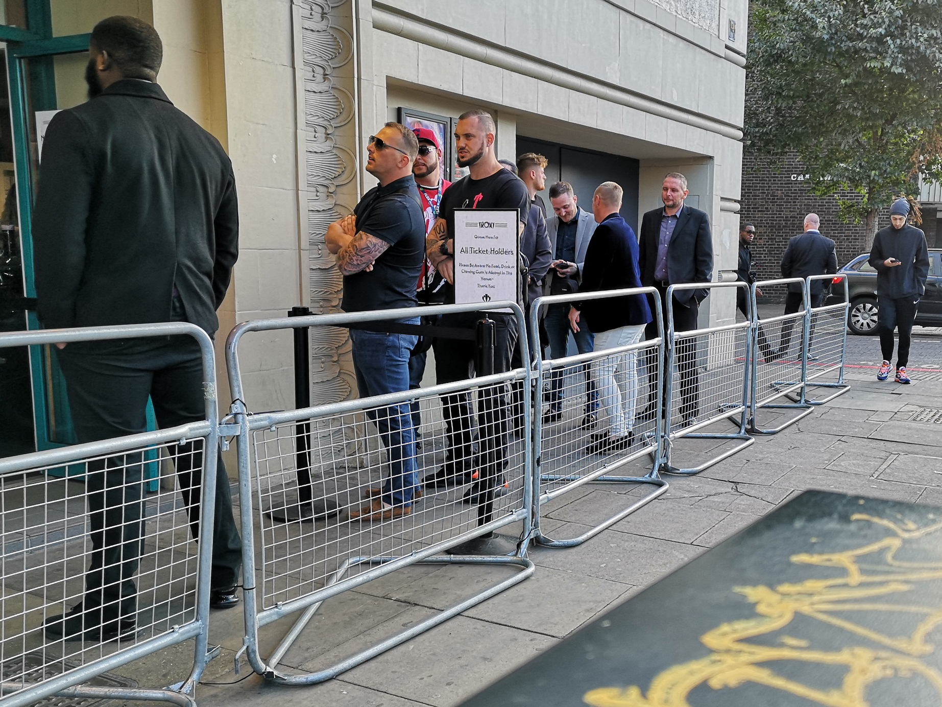 The queue for ticketholders is much more intimidating,to the point where I think security might not even check whether these people actually  have  tickets. Also that man's beard is amazing.