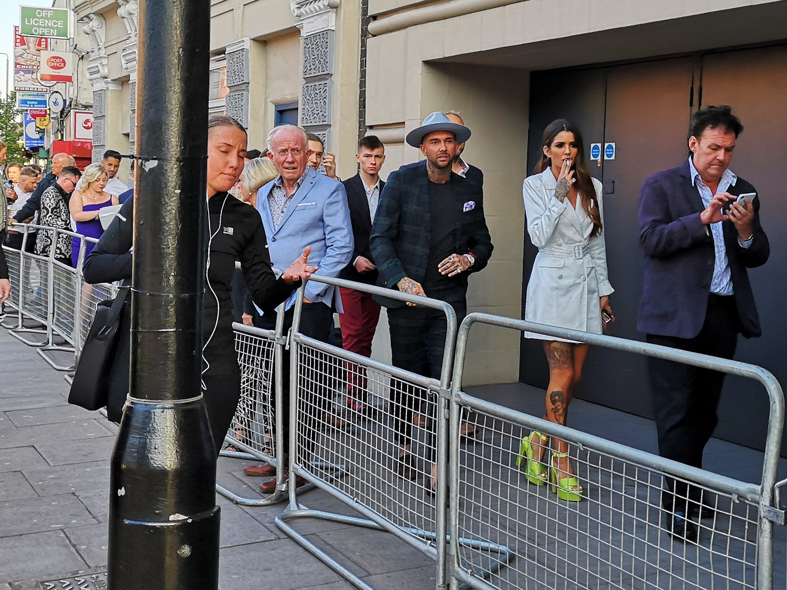 """Surely """"Man With Tattoos And Hat"""" is famous? (according to wireimage? No. But the lady in the light blue mini-trenchcoat and nuclear green shoes is """"Darylle Sargeant"""")"""
