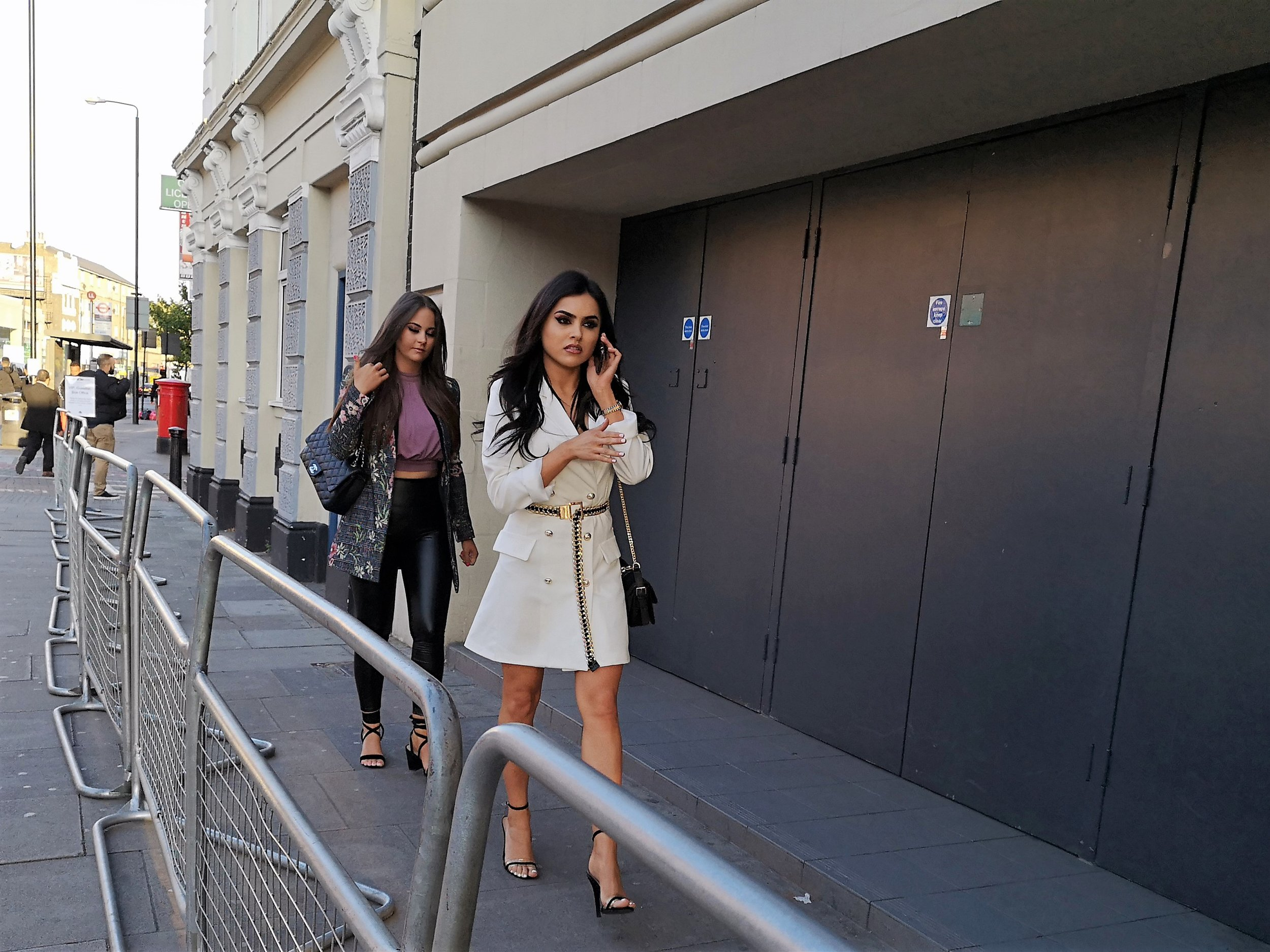 """""""Babes, I left home hours ago and I'm just in traffic at the moment. Hold on, I'm just going through a tunnel…."""" """"That would be easier to believe if I wasn't walking right behind you Babes""""  Per wireimage, the lady in front is Sofia Felipe… sadly wireimage elaborates no further."""