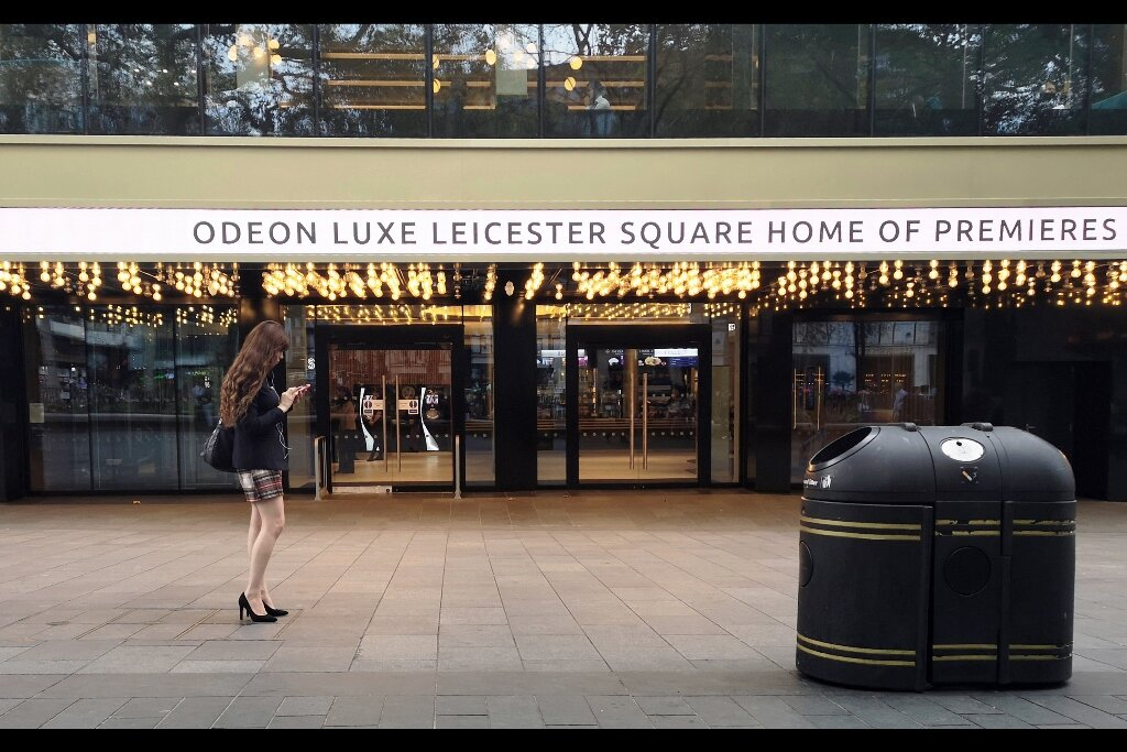 """""""I'm at the home of premieres, looking for a red carpet. Where are you?""""  Oh, me? I'm sitting here on this retaining wall taking photos of the front of the Odeon Leicester Square and not being at all creepy. Why do you ask?"""