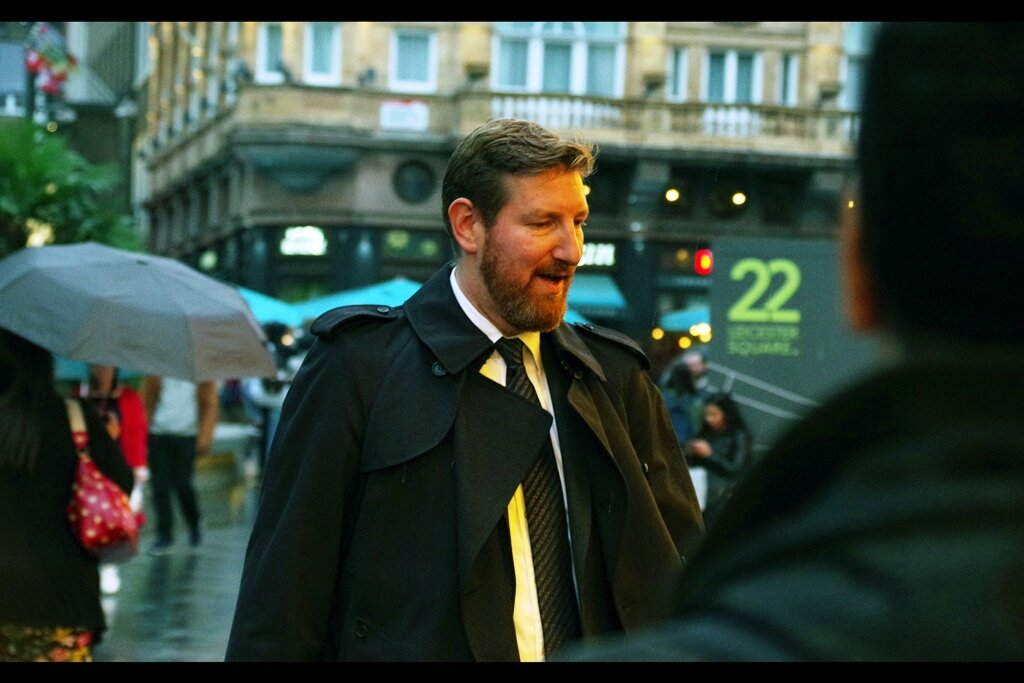 """Excitingly, this is Ben Turner, one of two directors of this documentary. Photographed in part because of the fetching overcoat he's wearing… and partly because my secret strategy at events is: """"Important People Don't Hold Tickets"""" and """"Important People Don't Hold Umbrellas"""". (They also usually wear slinkily dresses but that doesn't apply here)"""