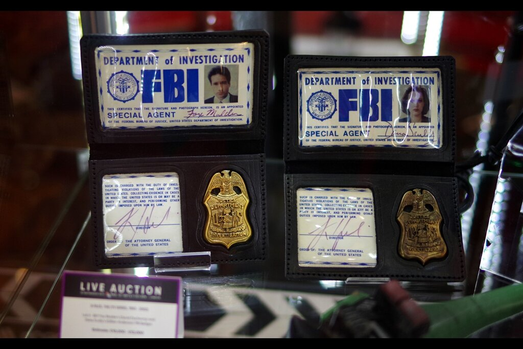 """Feedback from original owners :  """"Hey! How are we supposed to legally shoot people without them??""""  Mulder & Scully's FBI Badges from The X-Files (3rd Season) - NOT sold separately! Estimate: £10,000 - 12,000"""