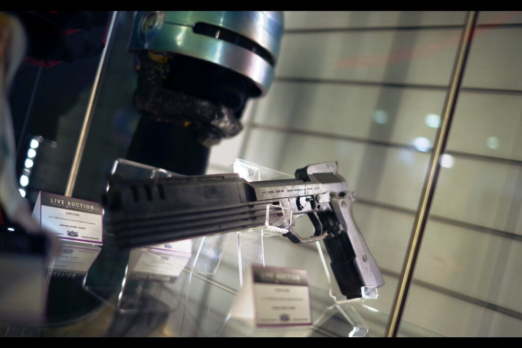 """Feedback from Original owner :  """"I'm getting a lot less respect without the gun and helmet, that's for sure""""  Robocop 2 Helmet (Estimated : £8,000 - 10,000) and Robocop 3 stunt pistol (Estimated : £3,000 - 5,000) Winning bids : £14,760 for the helmet, the pistol went unsold."""