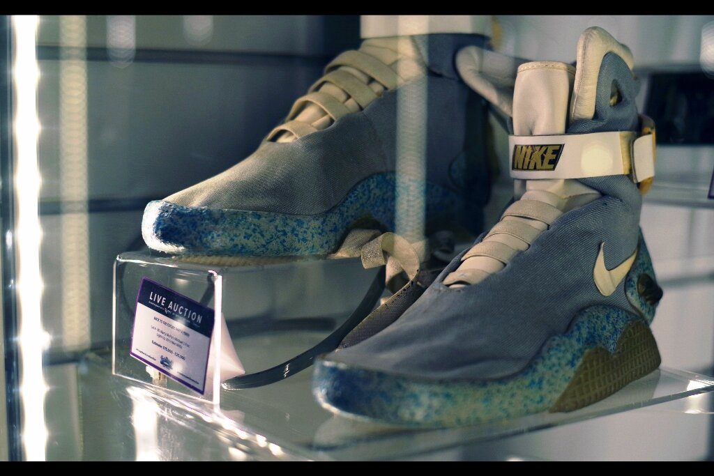 """Previous Owner's Feedback :  """"Power laces require a raised surface and a bunch of guys beneath you pulling on strings. Useful at piers, and above sewer grates, otherwise considerably less so.""""  Nike Air Mags from Back to the Future part2. Estimate: £15,000 - 25,000 Winning bid :   £65,190!!!!"""