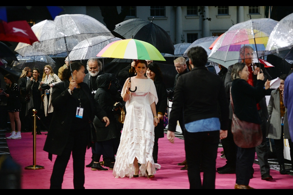 """""""The umbrella is keeping me dry, but on a Gross Domestic Product basis, I feel like my dress is considerably more valuable""""  Jessie Buckley is in this movie as 'Rosalyn Wilder', and is best known for the movies 'Beast',    'Wild Rose'    (which had a BFI LFF premiere) and the recent TV series 'Chernobyl' which even I'VE heard of."""