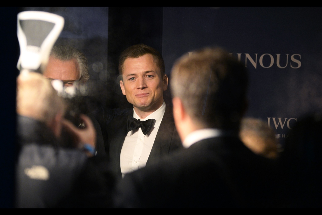 Taron Egerton shows a mixture of sympathy and smugness at being inside, adored, young and good looking…. as against we, the crazy people standing outside. And…. I'm…. not going to say he isn't mostly entirely correct in his attitude.