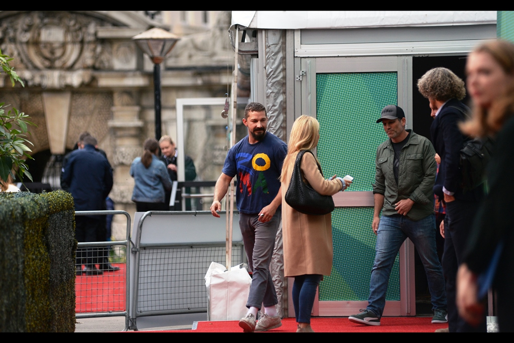 It's Shia Labeouf!! I've photographed him twice before : at    Transformers : Revenge of the Fallen    back in 2008, and the    Brad Pitt World War 2 tank movie 'Fury'  .  in 2014. His t-shirt says 'Roma' and he's waering sneakers. More news as I have it.