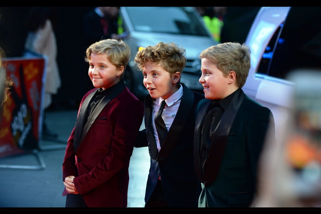 Roman Griffin-Davis poses with his two twin brothers… though the fact that none of them are putting bunny rabbits above each others' heads when being photographed by the press just feels kind of… un-brotherly.