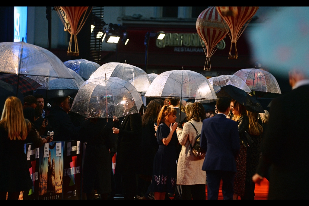 The predicted rain was predictable at this premiere. The only - ONLY - positives coming from this were that (1) guests had less inclination to linger on the red carpet since it was dry inside the cinema, and (2) my gear is waterproof…. I hope.