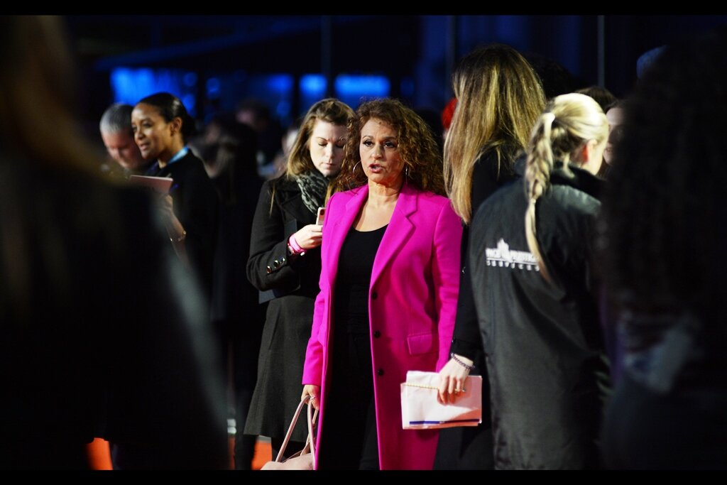 """People were shouting out   """"LANA!!! LANA!!!""""   for this lady, and she did get briefly interviewed. But she's not in the cast/crew, and not identified by wireimage. Still… bright pink jacket. My Pentax's autofocus approves of the contrast, while the Nikon's autofocus shrugs and keeps doing what it's doing"""