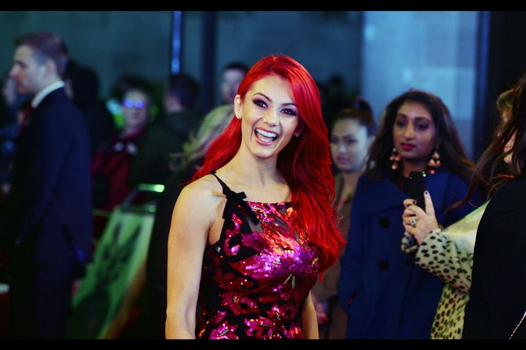 Dianne Buswell's smile faded about three frames later when her eyes rested on my camera. I mean.. I'm used to confusion when people notice the Pentax, but the NIKON? What's that all about?