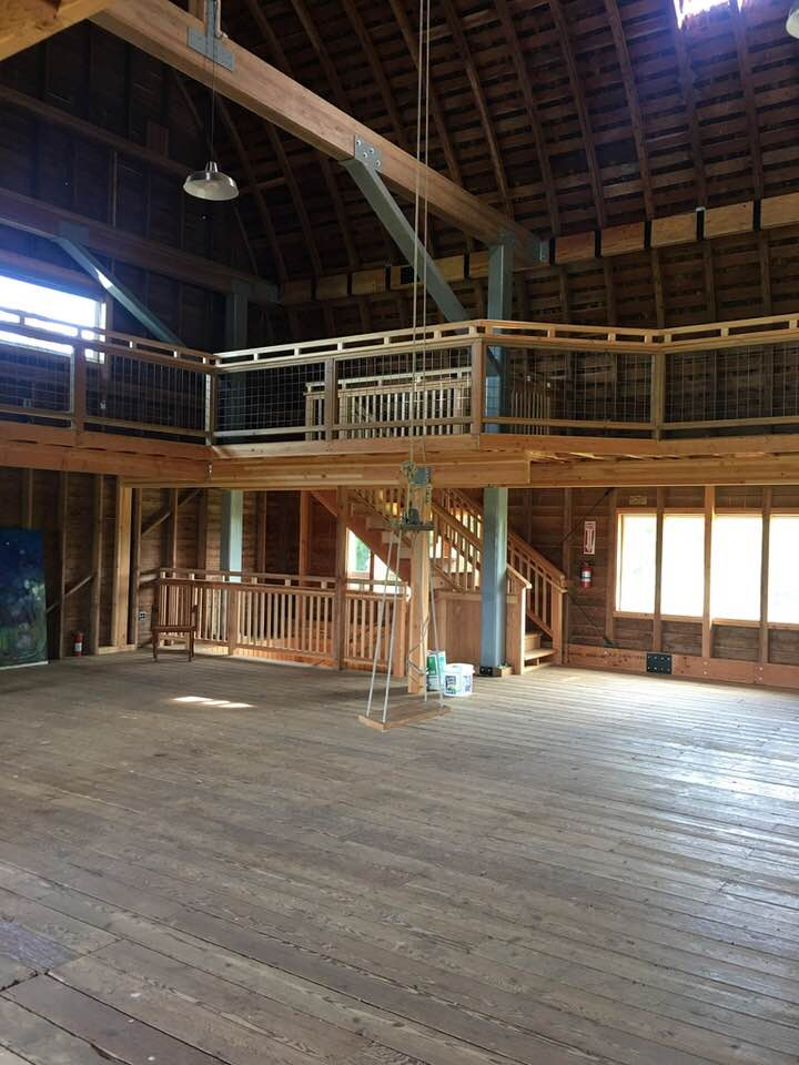 The Cline Barn was built in 1934 and was initially used as a Dairy Barn. This room would have been full of loose hay. Later it was used for local barn dances for the community. The former owners spent much time and care in restoring the barn by putting on a new roof, adding the stairs and mezzanine. The swing was originally here when the barn was built.
