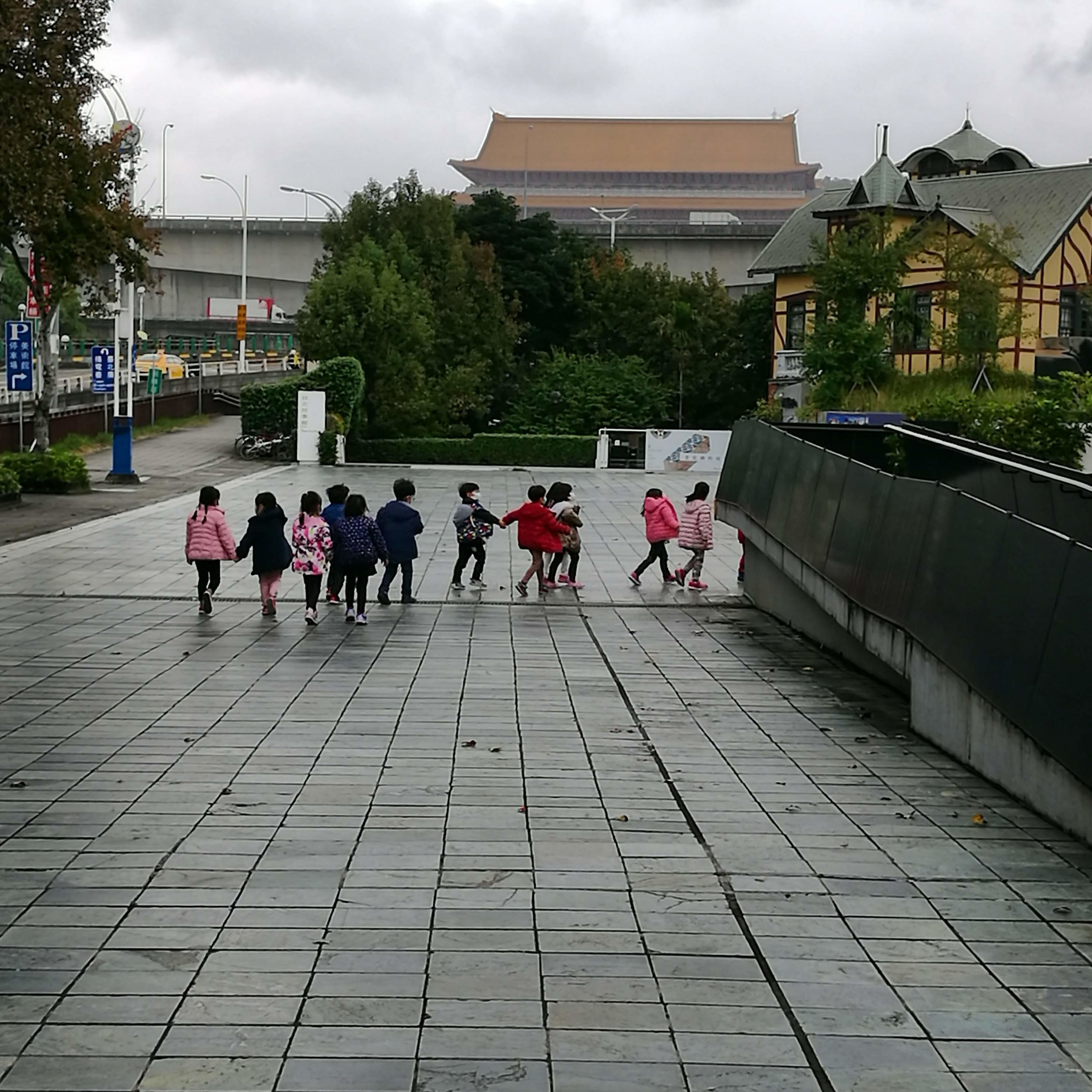 A group of school children walk up the steps to visit the 2018 Taipei Biennial. Photo: Leora Joy