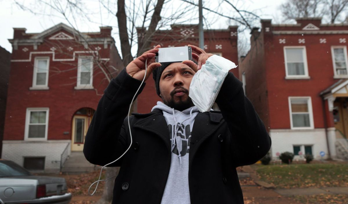 Activist Charles Wade of Austin, Texas, and Operation Help or Hush, photographs apartments in Dutchtown on Thursday, Dec. 18, 2014.  Wade is starting to move protesters from motels to transitional housing subsidized by the organization.  Photo by Robert Cohen, rcohen@post-dispatch.com