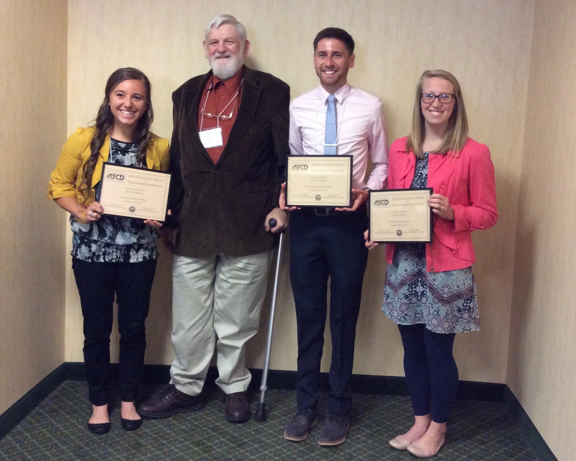 Stan Hooper and three 2017 award recipients