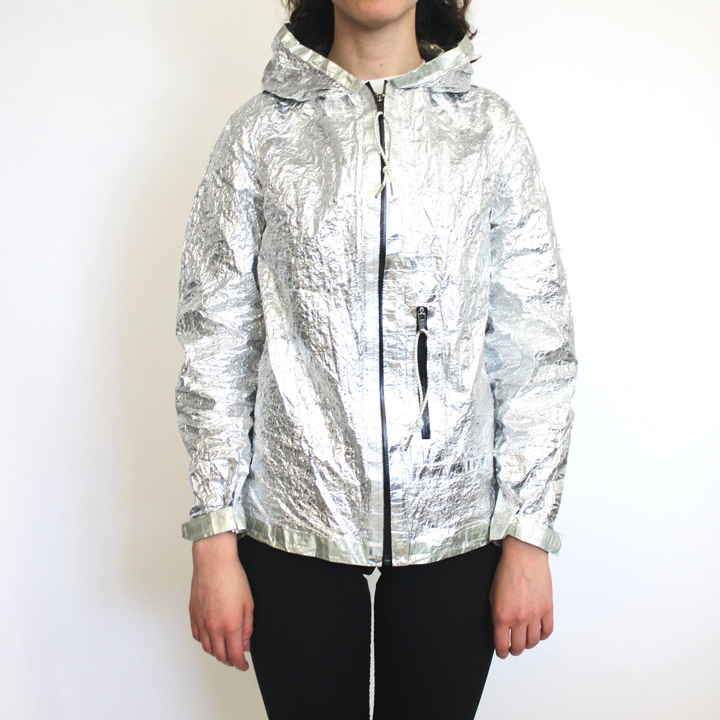 Emergency Jacket (E-Jacket) - FFD's Emergency Jacket is made from super lightweight non-woven dyneema fabric, bonded to mylar. The result is an exceptionally thin, durable garment that has excellent thermal properties, and can protect you against rain, wind, and exposure.Total weight is 4.75 Ounces! All seams are taped, which means they are inherently waterproof and have minimal added bulk. The entire jacket folds up smaller than a sandwich, and is appropriate for camping, biking, or urban adventures.The unique dyneema-mylar fabric is non-stretch, with a greenish outer shell and a pure silver mylar inner side; the jacket is reversible.