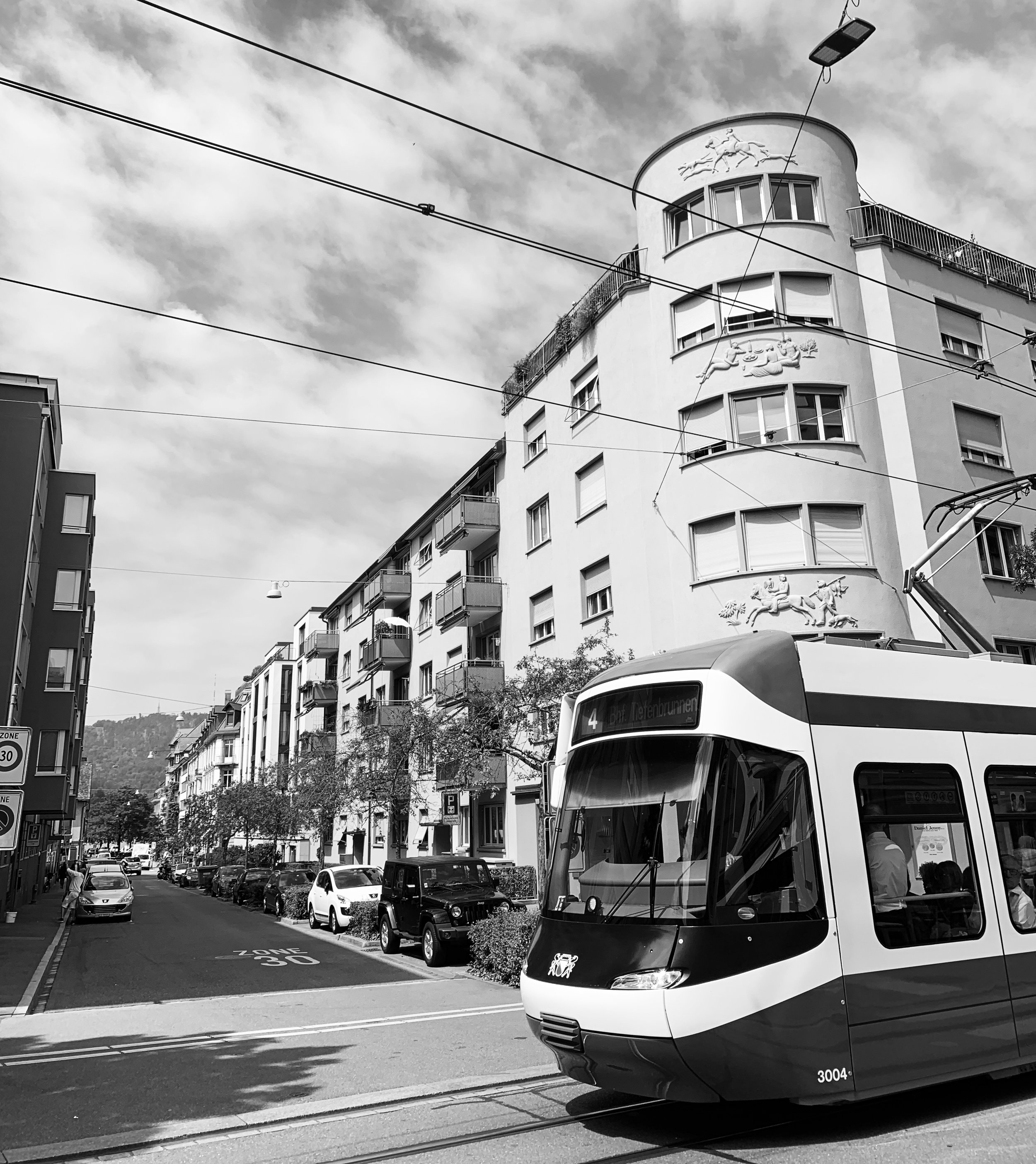 Seefeld, Zürich. People, life, trams, commerce, bikes, shade, clean air and easy access to lake Zürichsee.