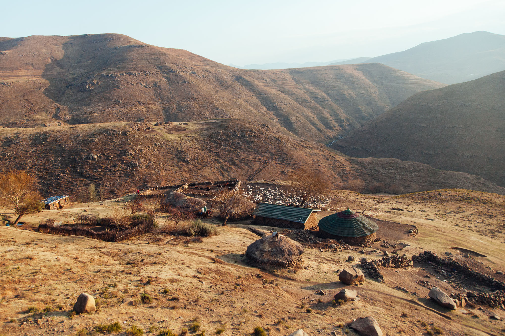 The family's group of rondavels nestled in the Thaba Putsoa Mountains