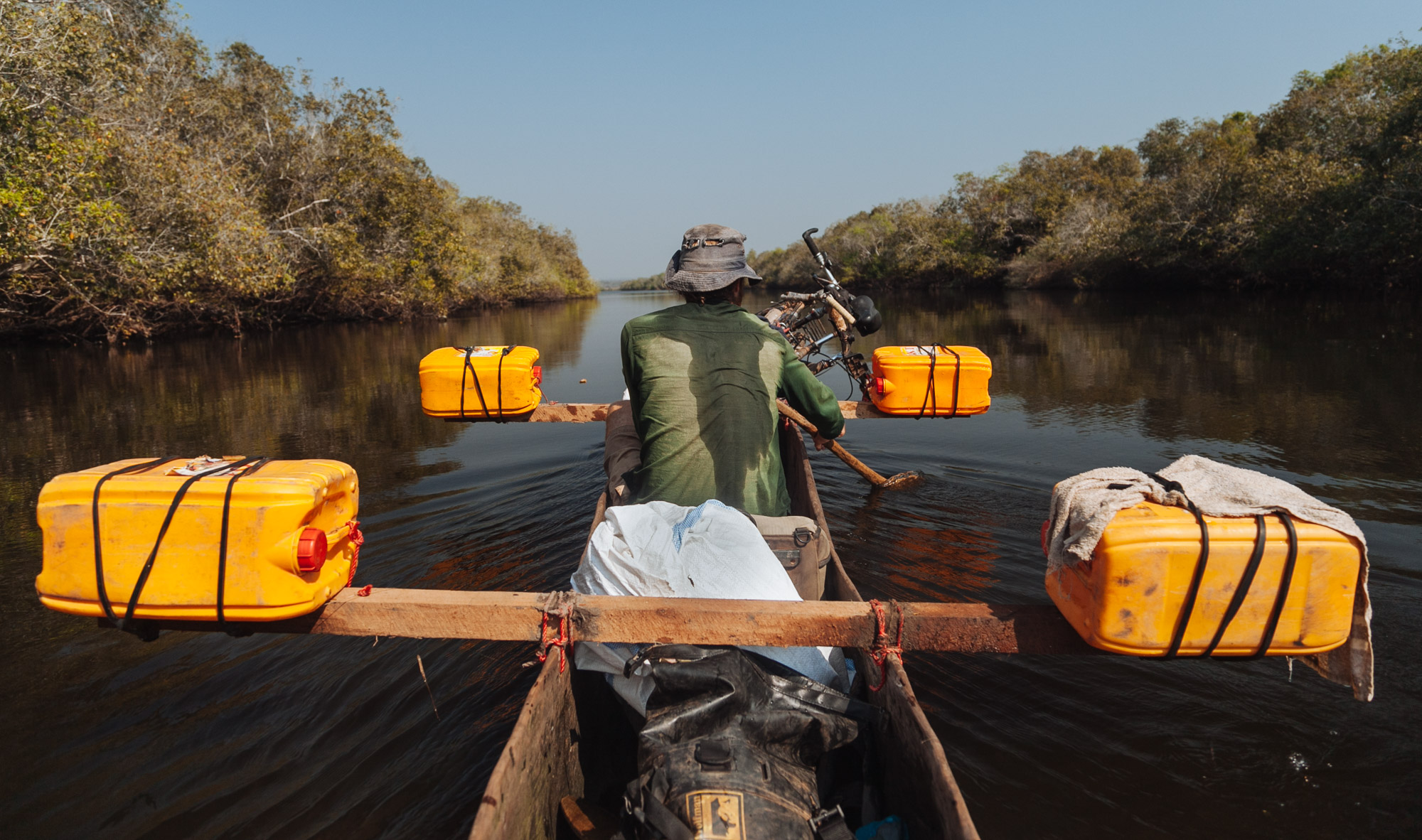 After previous experiences in Malawi with dugout canoes, we had learnt that they were not very stable so came up with this configuration in the hope of keeping us upright if we became unbalanced.