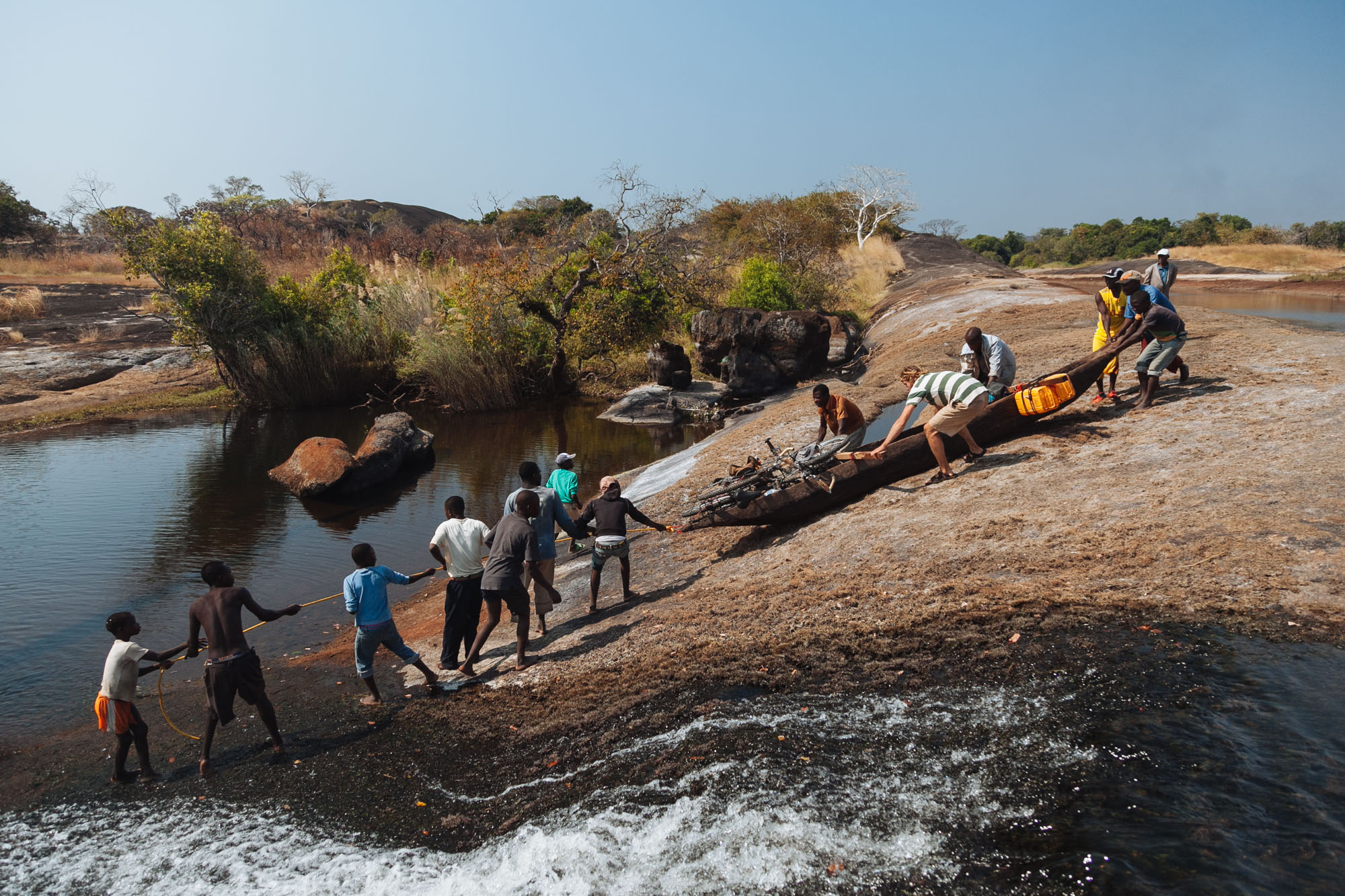 A local village helps us drag our pirogue overland to avoid a large 1km set of rapids.