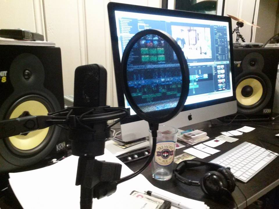 Editing in the home studio. The microphone and headphones are for doing my Voice-Overs.