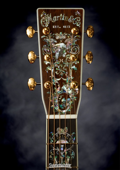 The fine details on the Martin D-100 deluxe. Work of art, or overpriced hunk of wood? You decide.