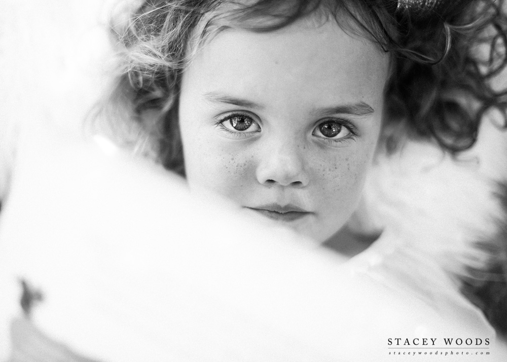 Peeping over her books in black and white || Stacey Woods, Florida children's lifestyle photographer