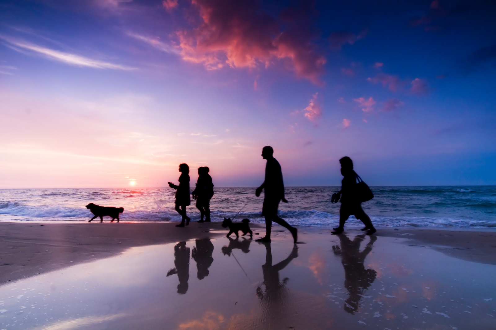bigstock-Family-walk-on-the-beach-at-su-18950786.jpg