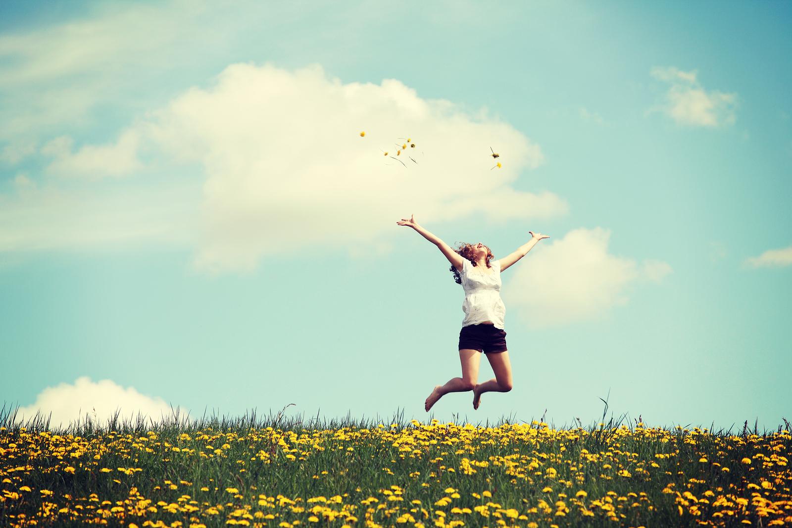 bigstock-Happy-woman-jumping-on-blossom-59295572.jpg