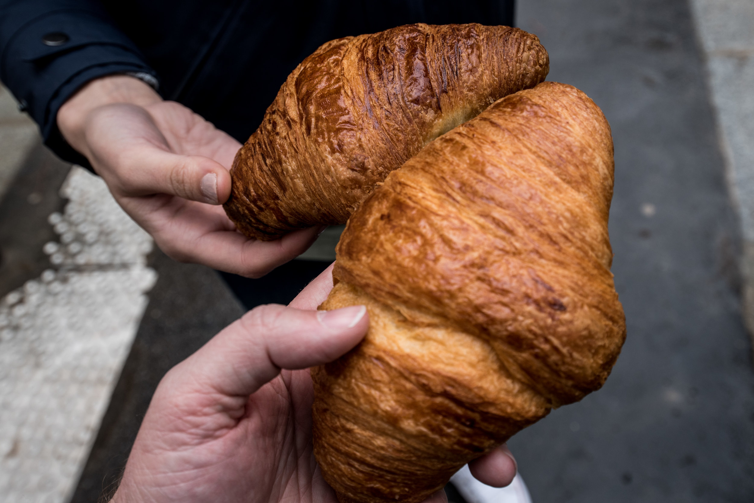 Straight croissants are made with butter. Curved croissants are made with margarine. You want the straight ones.