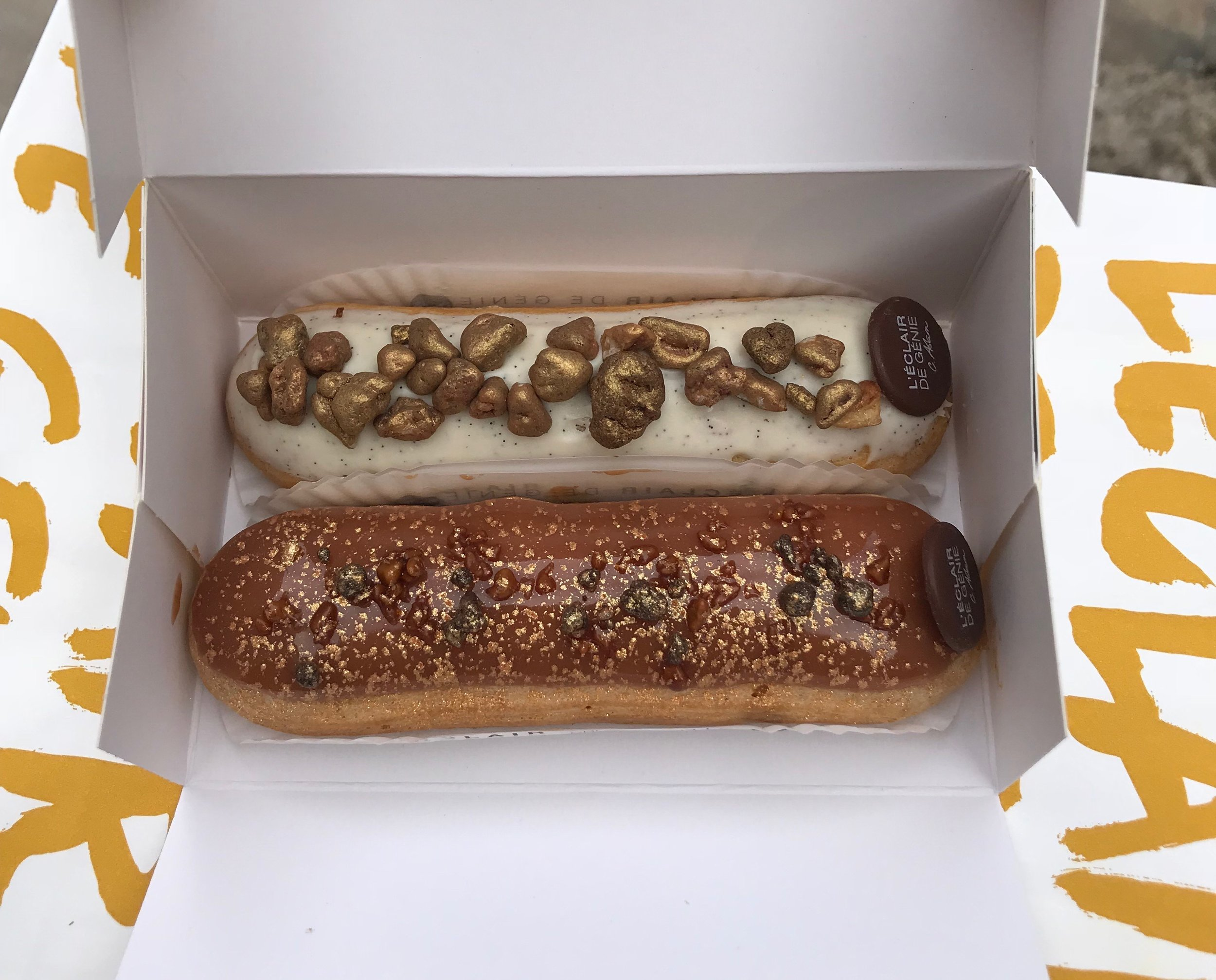 Eclairs with golden pecans.