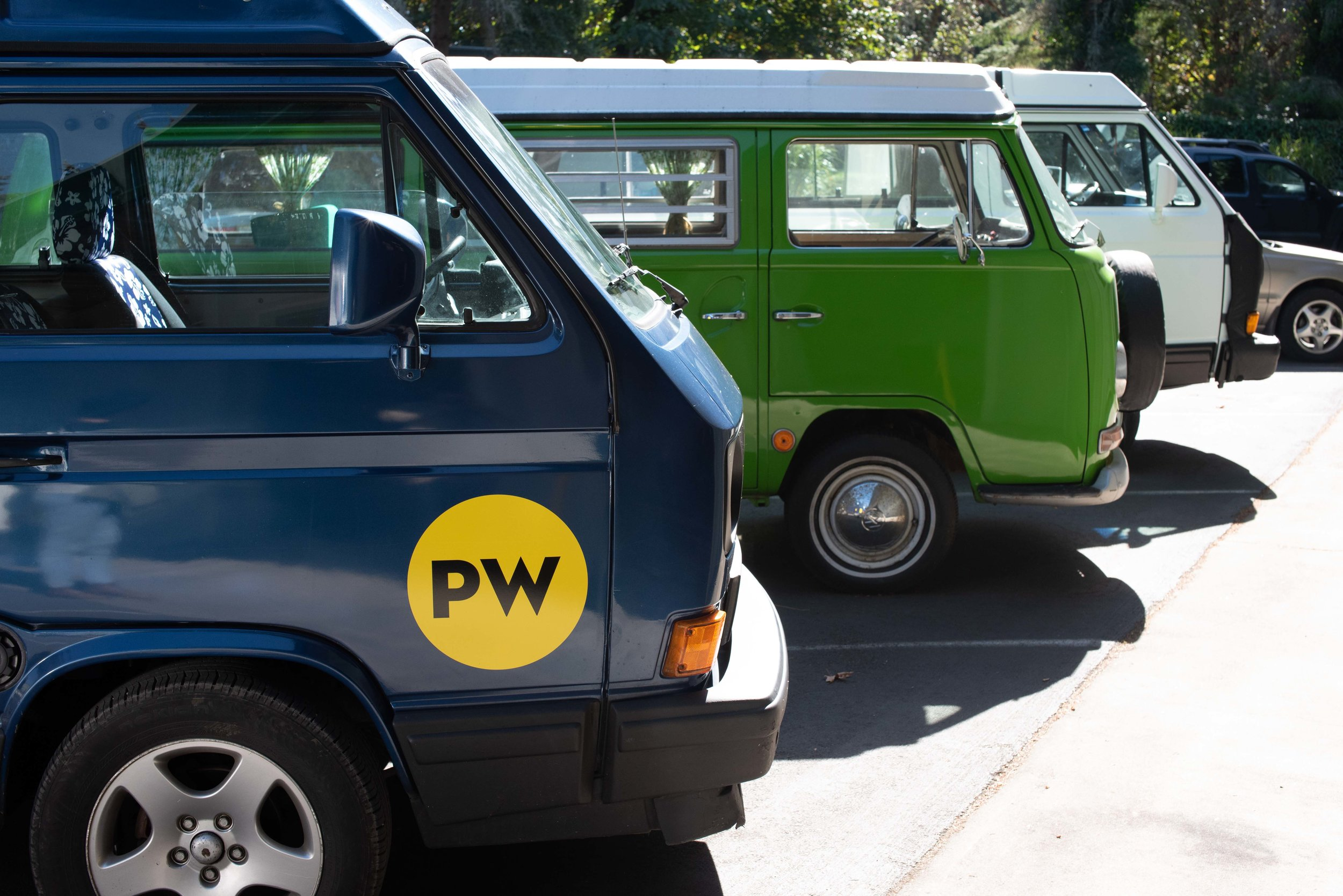 Some of Pacwesty's vans. Our van, Ernie, is the blue one in the front.