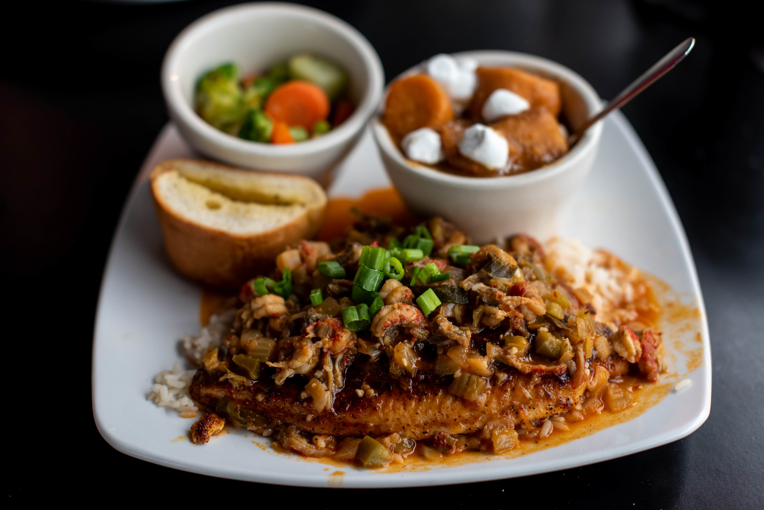 Grilled catfish toped with crawfish Étouffée