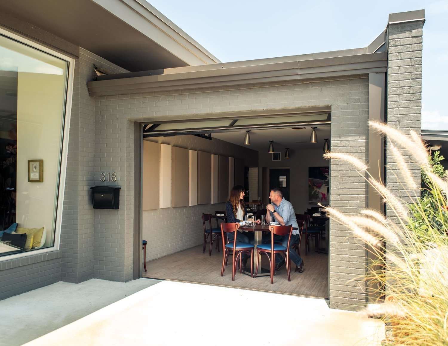 The garage door opens to let the outside in.
