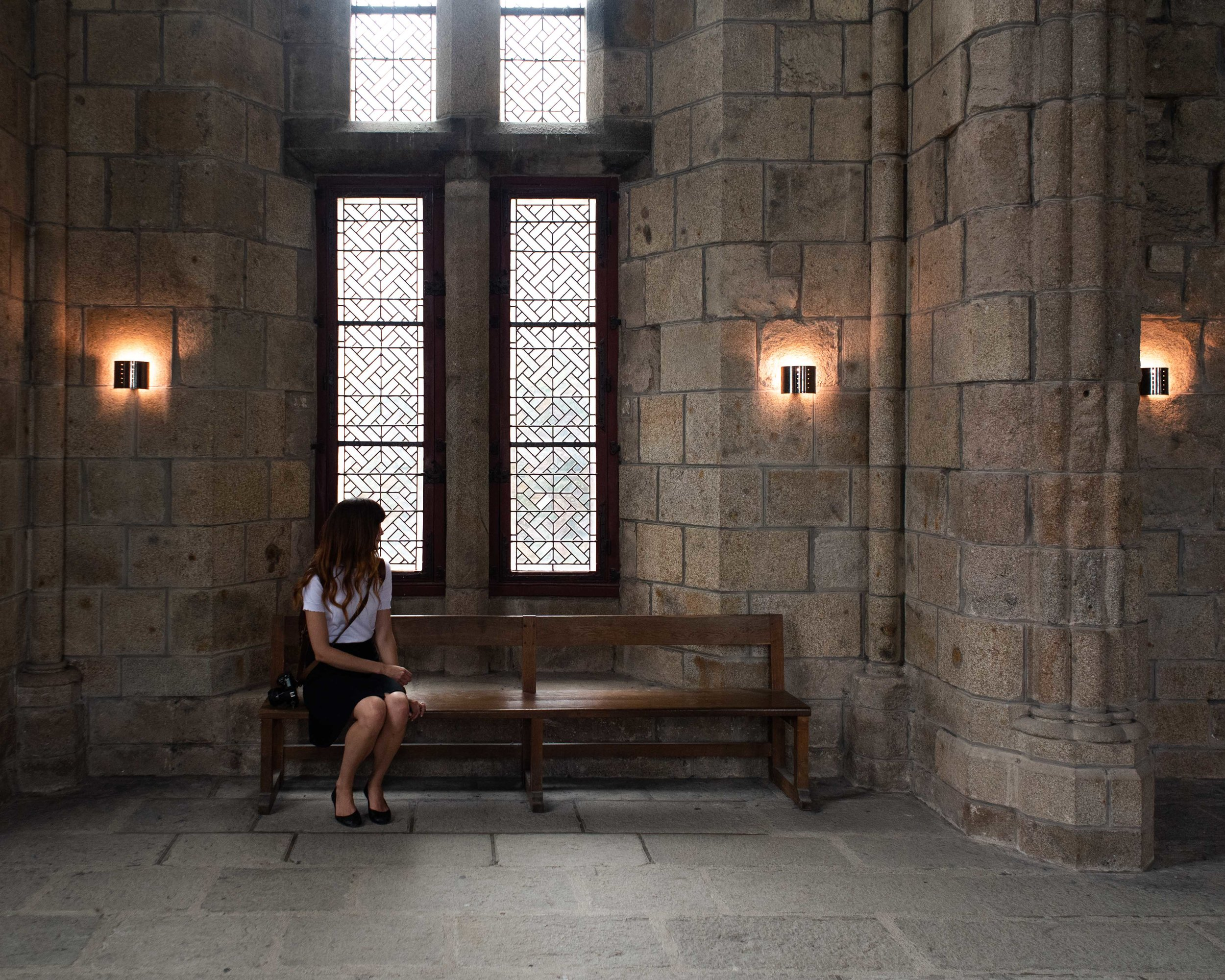 Charise sitting in the abbey.