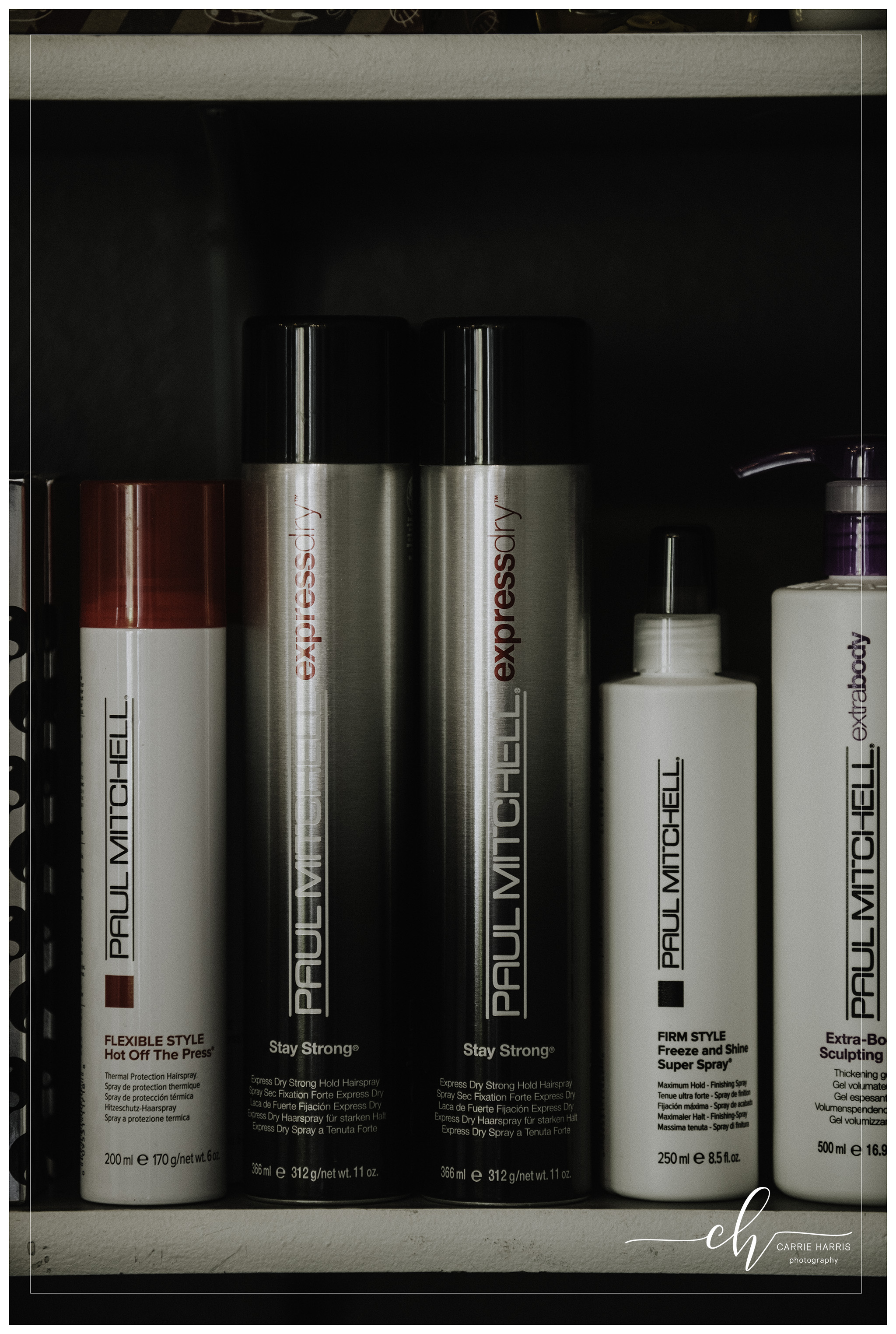 I learned that my beloved Paul Mitchell Express Dry hairspray may not be the best choice on portrait day. You'll want a lighter hairspray that can be layered and won't pull your hair down. We don't want flat hair in your photos!