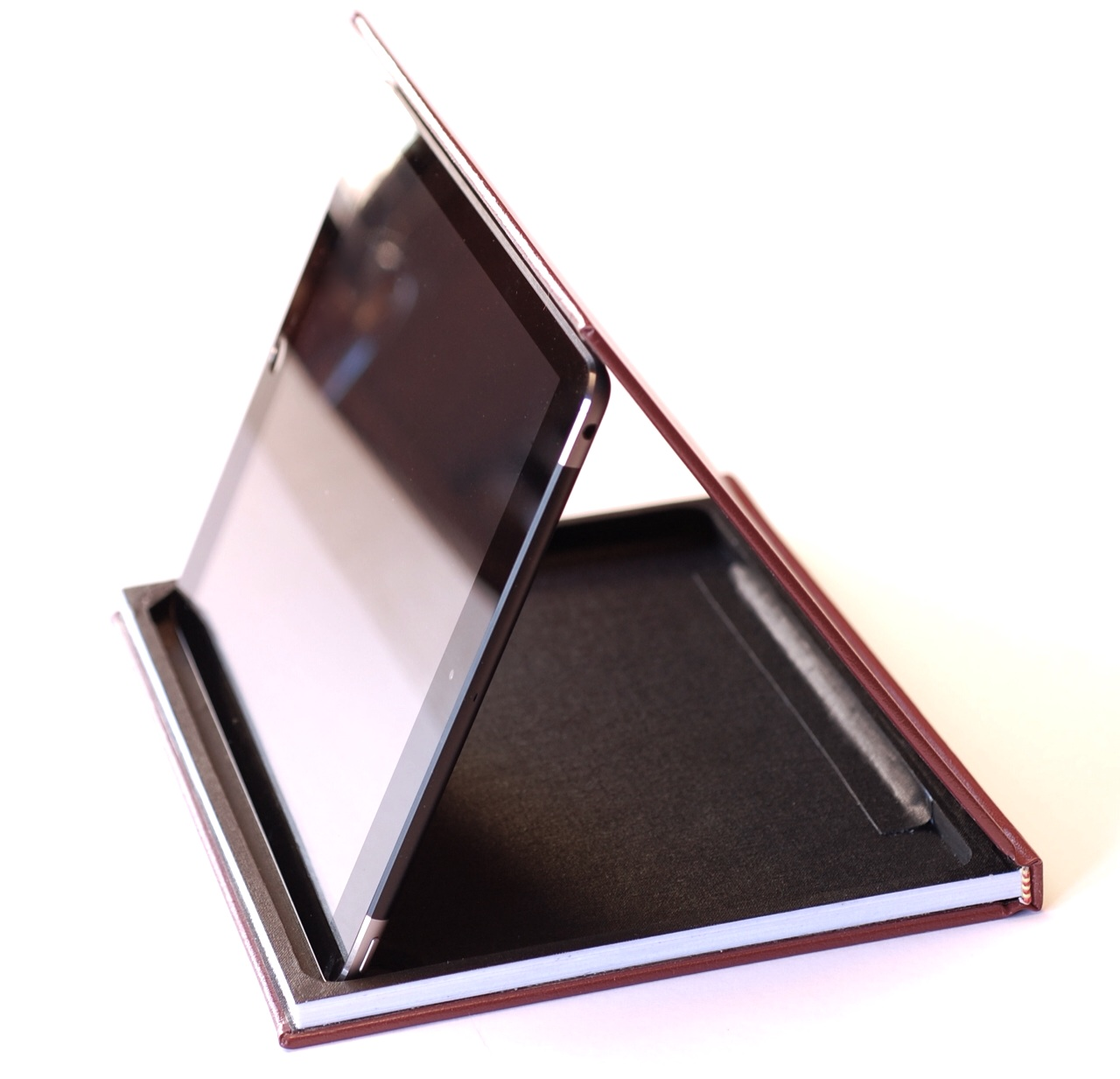 iPad magnets secure the iPad to the case for a variety of viewing positions.
